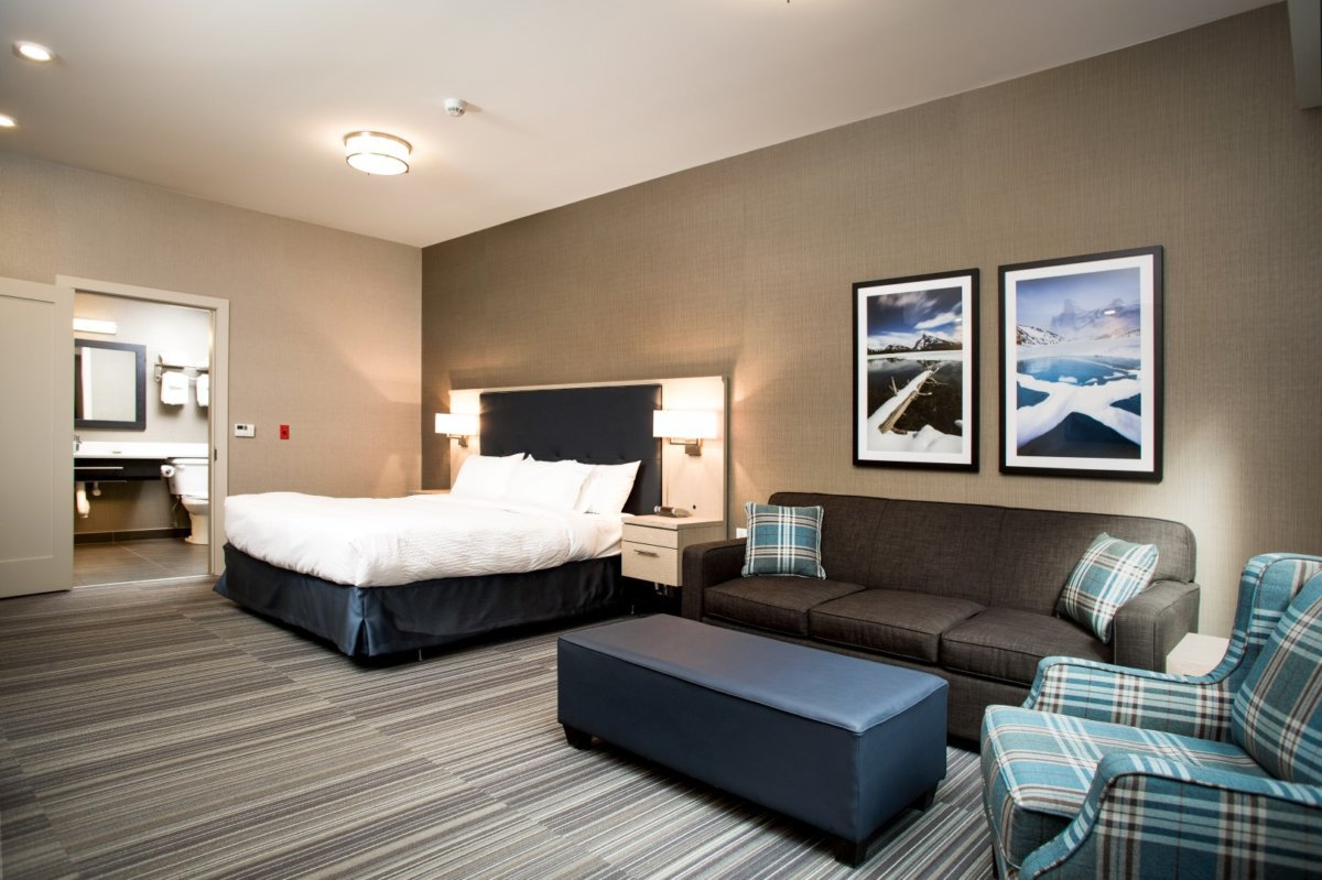 Satellite Tv Internet >> King Guest Room with Sofa Bed | Mountaineer Lodge | Lake Louise